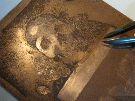 scraping and burnishing a copper etching plate