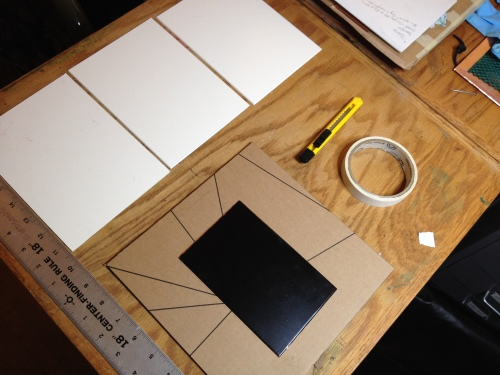 Three mats, a ruler, utility knife, cutting surface, acid-free tape, and your plate.